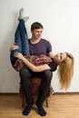The woman is lying upside down on man's knees Royalty Free Stock Photo