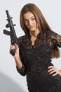 Woman with machine gun young posing toy Stock Image