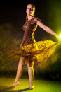 Woman magic dance beautiful happy sensual pretty wearing long brown dress spinning in in the dark studio Royalty Free Stock Photo