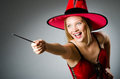 Woman magician doing her tricks with wand Stock Image