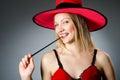 Woman magician doing her tricks with wand Stock Photos
