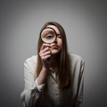 Woman with magnifier young looking through loupe Stock Images