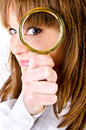 Woman with magnifying glass Royalty Free Stock Image