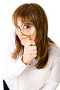 Woman with magnifying glass Stock Photography