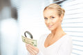 Woman with magnifying glass and money Royalty Free Stock Images