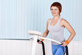 Woman make exercise on training apparatus Royalty Free Stock Photography