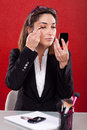 Woman on the make up work business Stock Images