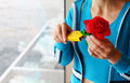 Woman makes artificial red rose Stock Image