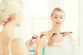 Woman with makeup brush and eyeshade at bathroom Royalty Free Stock Photo