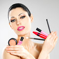 Woman with makeup cosmetic tools near her face beautiful Stock Image