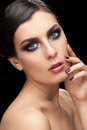 Woman with makeup and manicure fashion studio shot of young beautiful bright Stock Image