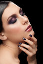 Woman with makeup and manicure fashion studio shot of young beautiful bright violet Royalty Free Stock Photography