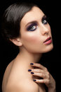 Woman with makeup and manicure fashion studio shot of young beautiful bright violet Stock Photo