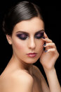 Woman with makeup and manicure fashion studio shot of young beautiful bright violet Stock Photos