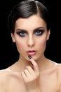 Woman with makeup and manicure fashion studio shot of young beautiful bright violet Stock Image