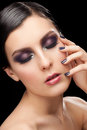 Woman with makeup and manicure fashion studio shot of young beautiful closed eyes bright violet Royalty Free Stock Image