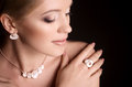 Woman with makeup portrait of beautiful young in luxury jewelry Stock Photography