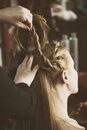 Woman making braids at hair studio Royalty Free Stock Photo