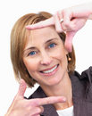Woman making a frame shape with her hands Stock Photo