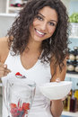 Woman making fruit smoothie in kitchen a beautiful happy young or girl a fresh her at home Stock Photography