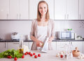 Woman making healthy food in kitchen Royalty Free Stock Photo