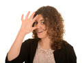 Woman making a rude gesture portrait of smiling with her hand on her nose white studio background Stock Photography