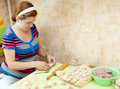 Woman making russian meat dumplings Royalty Free Stock Photo