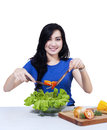 Woman making salad happy young fresh vegetables Royalty Free Stock Photos