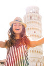 Woman making selfie in front of tower of pisa Royalty Free Stock Photo