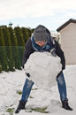 Woman making snowman