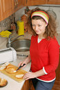 Woman making toast sandwiches Stock Photography