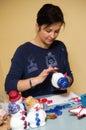 Woman making toy snowman Royalty Free Stock Photo