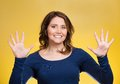 Woman making two times five sign gesture with hands, fingers, number ten Royalty Free Stock Photo