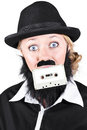 Woman in male costume holding cassette in mouth wearing bowler hat dressed as a man Stock Photos