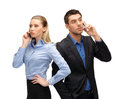 Woman and man with cell phones calling business technology communication concept businesswoman businessman Royalty Free Stock Photography