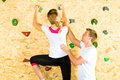 Woman and man climbing at climbing wall Stock Image