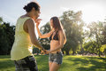 Woman and man dancing salsa in summer park Royalty Free Stock Photo