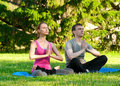 Woman and man doing yoga exercise Royalty Free Stock Photos