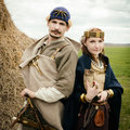Woman and man in ethnic suit context historical reconstruction men of Royalty Free Stock Photography