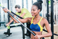 Woman and man in functional training for better fitness men sport gym Stock Image