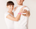 Woman and man hands with pregnancy test close up of women men Stock Images
