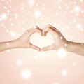 Woman and man hands showing heart shape love family harmony concept Royalty Free Stock Photo