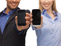 Woman and man hands with smartphones close up of women men Royalty Free Stock Images