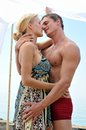 Woman and man kissing at the beach. Royalty Free Stock Photography