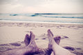 Woman and man legs and foot in the beach vintage style Stock Photo