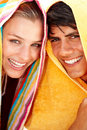 Woman and man with a towel over their heads Stock Images