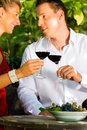 Woman and man in vineyard drinking wine Stock Image