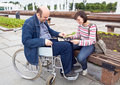 Woman and man on an wheelchair Royalty Free Stock Photo