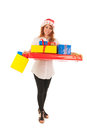 Woman with many christmas gifts young standing in studio Royalty Free Stock Images