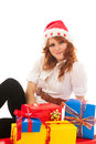 Woman with many christmas gifts young standing in studio Royalty Free Stock Photos